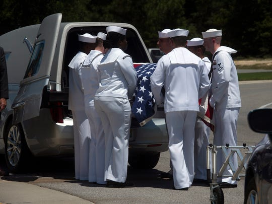 The remains of John Schoonover, a sailor killed on the USS Oklahoma during the Japanese attack on Pearl Harbor are removed from a hearse by a Navy Honor guard at Barrancas National Cemetery on board Pensacola Naval Air Station, Tuesday, June 26, 2018. DNA was used to identify the remains nearly 80-years after his death.