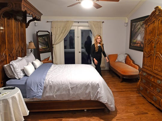 Leyicet Peralta  shows one of the bedrooms available at Danny Gokey's Bed and Breakfast in BrentwoodWednesday Jan. 11, 2017, in Brentwood, Tenn.
