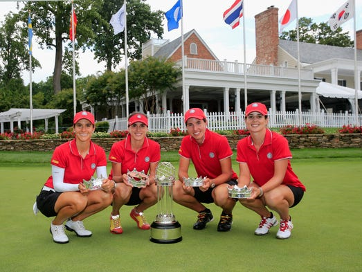 From left: Azahara Munoz, Belen Mozo, Carlota Ciganda, and Beatriz Recari of Spain pose with the trophy after winning the International Crown at Cave Valley Golf Club.