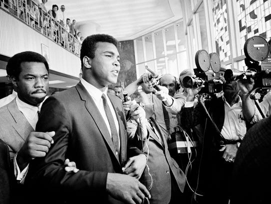 In this June 19, 1967, file photo, Muhammad Ali leaves