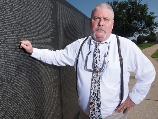 Pensacola resident, Perry Hunter, visits the Wall South