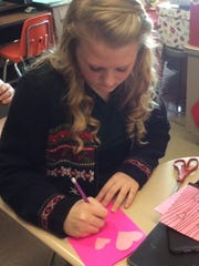 Students made valentines for veterans during English class.