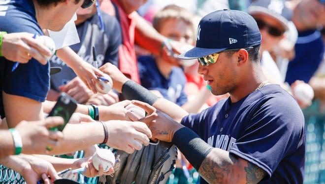 Mar 24, 2018; Lake Buena Vista, FL, USA; New York Yankees Gleyber Torres signs autographs before the game against the Atlanta Braves at Champion Stadium.