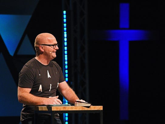 Adam Weber, lead pastor at Embrace Church, speaks during