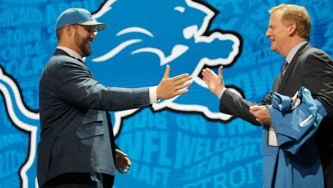Taylor Decker greets NFL commissioner Roger Goodell during the NFL draft Thursday in Chicago.