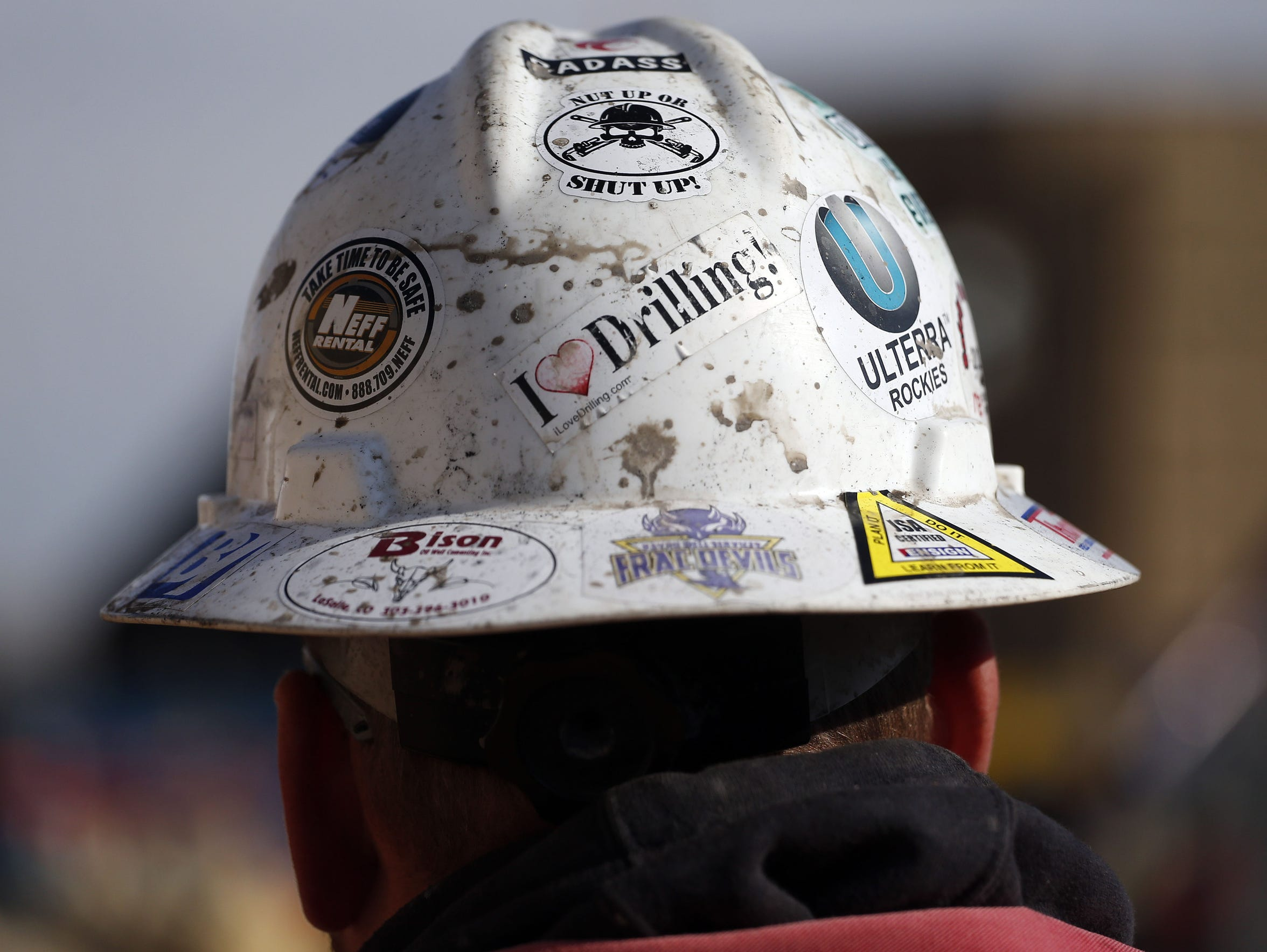 In this March 25, 2014 photo, a worker wears a protective