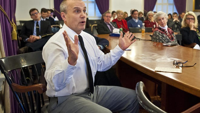 Rep. Tom Burditt, R-West Rutland, asks a question after the presentation of a RAND Corporation report on the impact of legalizing marijuana in 2015 at the Statehouse in Montpelier.