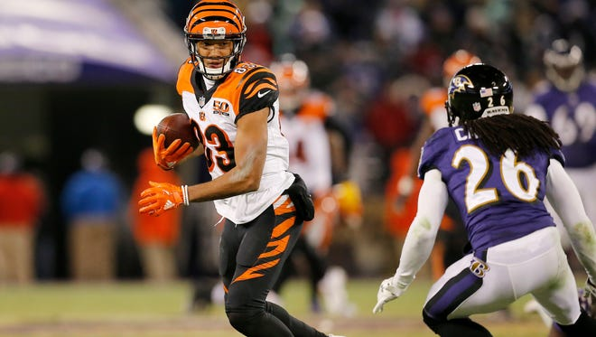 Cincinnati Bengals wide receiver Tyler Boyd (83) makes the turn after a catch before running in for the go-ahead touchdown in the fourth quarter of the NFL Week 17 game between the Baltimore Ravens and the Cincinnati Bengals at M&T Bank Stadium in Baltimore on Sunday, Dec. 31, 2017. The Bengals won 31-27 in the regular season finale.