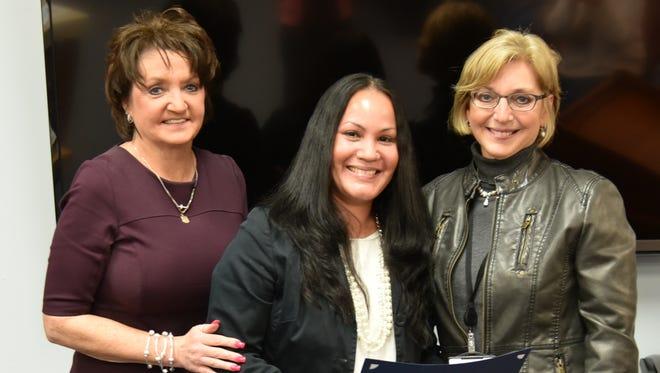 Preschool aide Jennifer Cortes (center) is honored by Vineland school board member Kim Codispoti (left) and preschool principal Lynn Monteleone.
