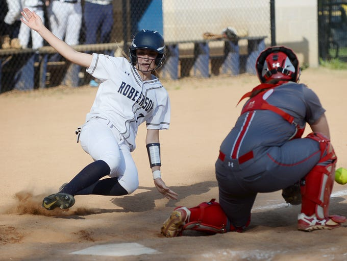 Roberson's Madison Dillner slides safely into home