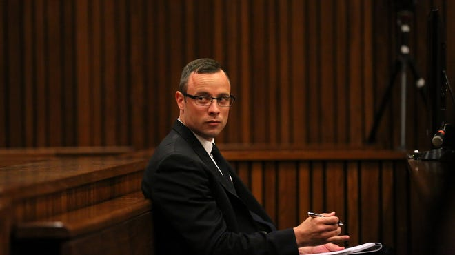 Oscar Pistorius sits in the dock during his trial in connection with the death of his girlfriend Reeva Steenkamp, at the North Gauteng High Court in Pretoria, South Africa, on Tuesday.