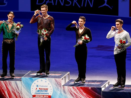 From left, silver medalist Jason Brown,  gold medalist Jeremy Abbott, bronze medalist Max Aaron and fourth-place finisher Joshua Farris pose after the men's competition at the 2014 U.S. Figure Skating Championships in Boston.