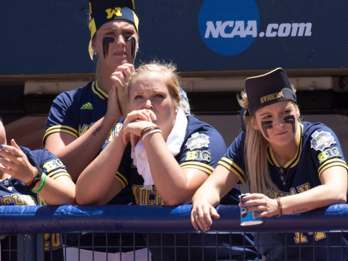 Players on the Michigan bench, including  Megan Betsa