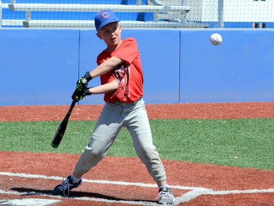 Trey Tarvin, 9, of Loving swings at the plate during