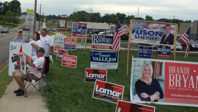 The first day of early voting in 2014 in Montgomery County brought out enthusiastic candidates and supporters, but fewer voters than expected.