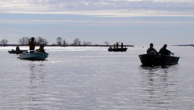 Boats gather for fishing in the Wisconsin River below the Nekoosa Dam in 1999.