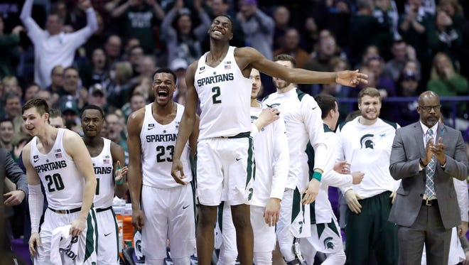 Michigan State forward Jaren Jackson Jr. smiles as he celebrates with teammates after guard Cassius Winston made a 3-point basket in the second half Saturday.
