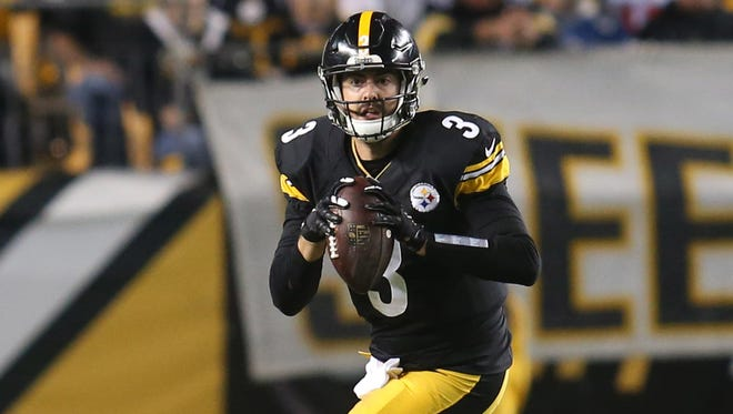 Pittsburgh Steelers quarterback Landry Jones (3) scrambles with the ball against the New England Patriots during the fourth quarter at Heinz Field.