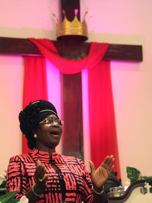 Dr. Linda Watkins celebrates along with visitors to the Jesus Christ Outreach Center during the Dr. Martin Luther King Jr. Commemorative Ecumenical Service on Sunday evening.