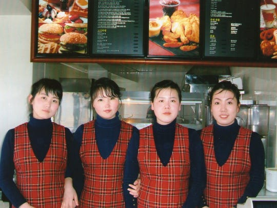 Staff at Samtaesong, the first fast-food franchise