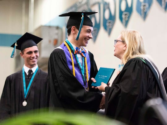 Senior Class President Courtland Campo receives his diploma from Martin County School District Superintendent Laurie Gaylord during the Jensen Beach High School Class of 2018 commencement ceremony on Monday, May 21, 2018, at Jensen Beach High School in Jensen Beach. The school district will receive more recognition funds this year compared to previous years.