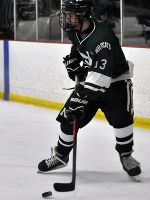 Novi's Bryan Fegert (13) looks to pass in Saturday's 6-1 win over South Lyon at the Kensington Valley Ice House