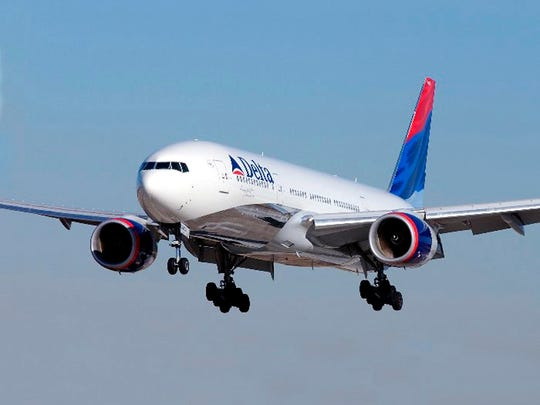 A Delta Air Lines Boeing 777 flies March 10, 2005.