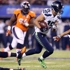 Feb 2, 2014; East Rutherford, NJ, USA; Seattle Seahawks wide receiver Jermaine Kearse (15) runs for a touchdown against the Denver Broncos during the third quarter in Super Bowl XLVIII at MetLife Stadium.