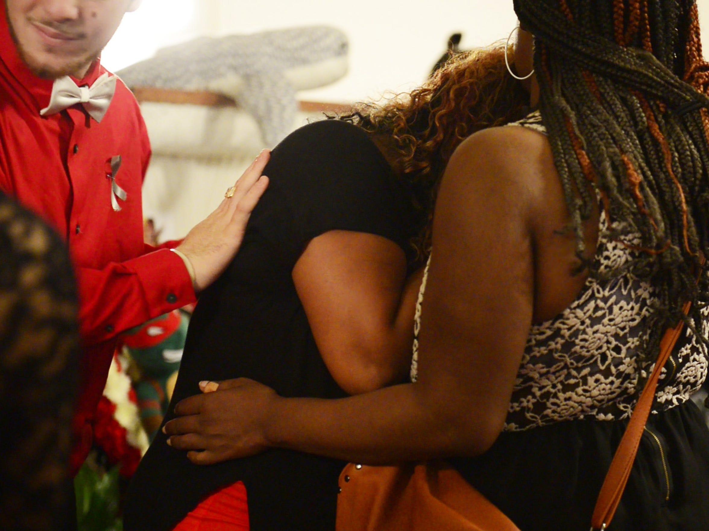 Tae's family mourns him at Findlay's Mason AME Chapel.