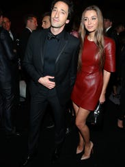 Actor Adrien Brody (L) and Lara Lieto make the scene