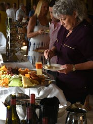 """Lori Passini makes her food selections. """"Glory of the"""