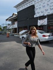 Stephanie Sayre heads into Beall's. Shops and restaurants
