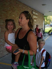 Leah Rice, 3, is tearful in mother Hallie's arms even