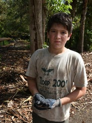 Joseph Ritter, 12, gets his Boy Scout shirt good and