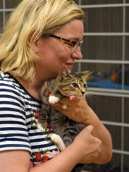 Ericka Basile with an adoptable kitten at Marco Island's
