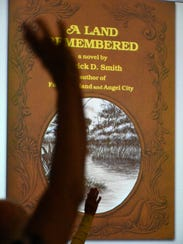 Hands go up as Patrick Smith Jr., son of author Patrick