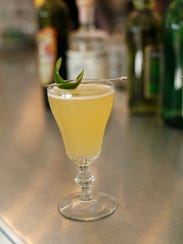 Subtle Menace is created with absinthe, balanced with lime juice, simple syrup, Sauvignon blanc and Tanqueray gin.