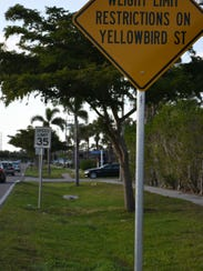 Signage announces the new restrictions. Yellowbird