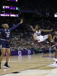 Mississippi State's Jazzmun Holmes (10) jumps high