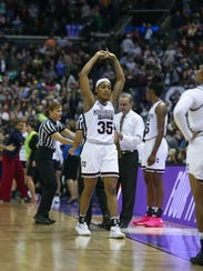 Mississippi State's Victoria Vivians (35) holds her