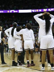 Mississippi State players react as officials review