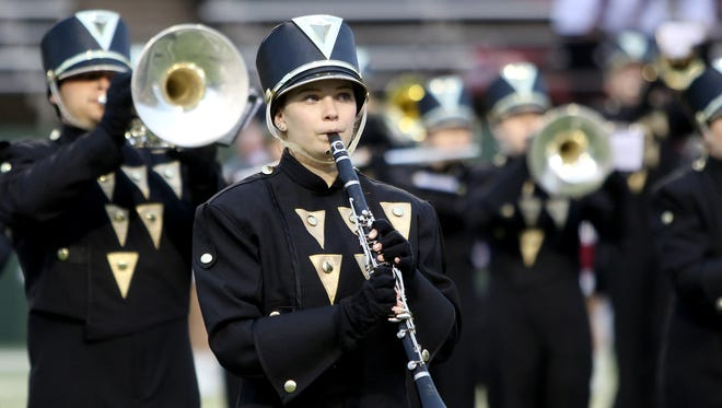 The Rider marching band performs the National Anthem before the Raiders game against Sherman Thursday, Sept. 28, 2017, at Memorial Stadium.