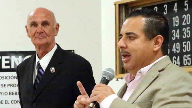 Carlos Aguilar, a former county commissioner, stumps for county judge candidate John Cook in Spanish during Cook's visit to the South El Paso Senior Center on Tuesday.