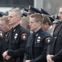 Officers line up at the conclusion of the memorial service for Trevor Casper Sunday March 29, 2015 in Kiel.