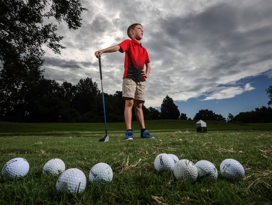 Luke Bryant, 8, poses on the tee at the second hole