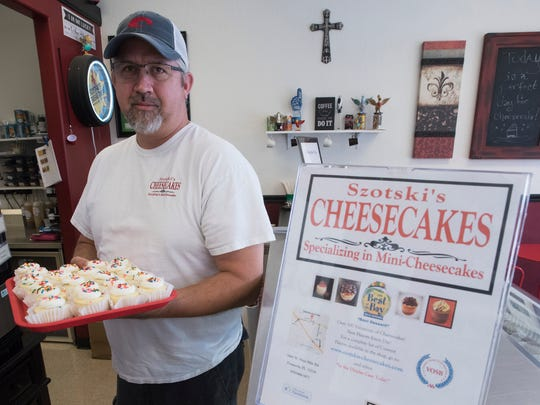 Jason Szot, the owner of Szotski's Cheesecakes, shows off a batch of mini cheesecakes on Monday, Aug. 21, 2017.