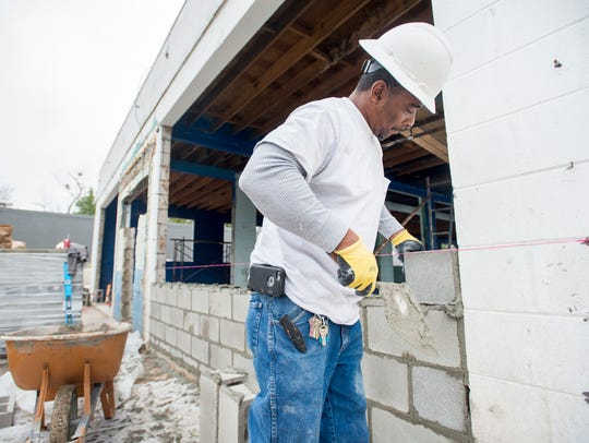 Emerald Coast Constructors employees work Wednesday,