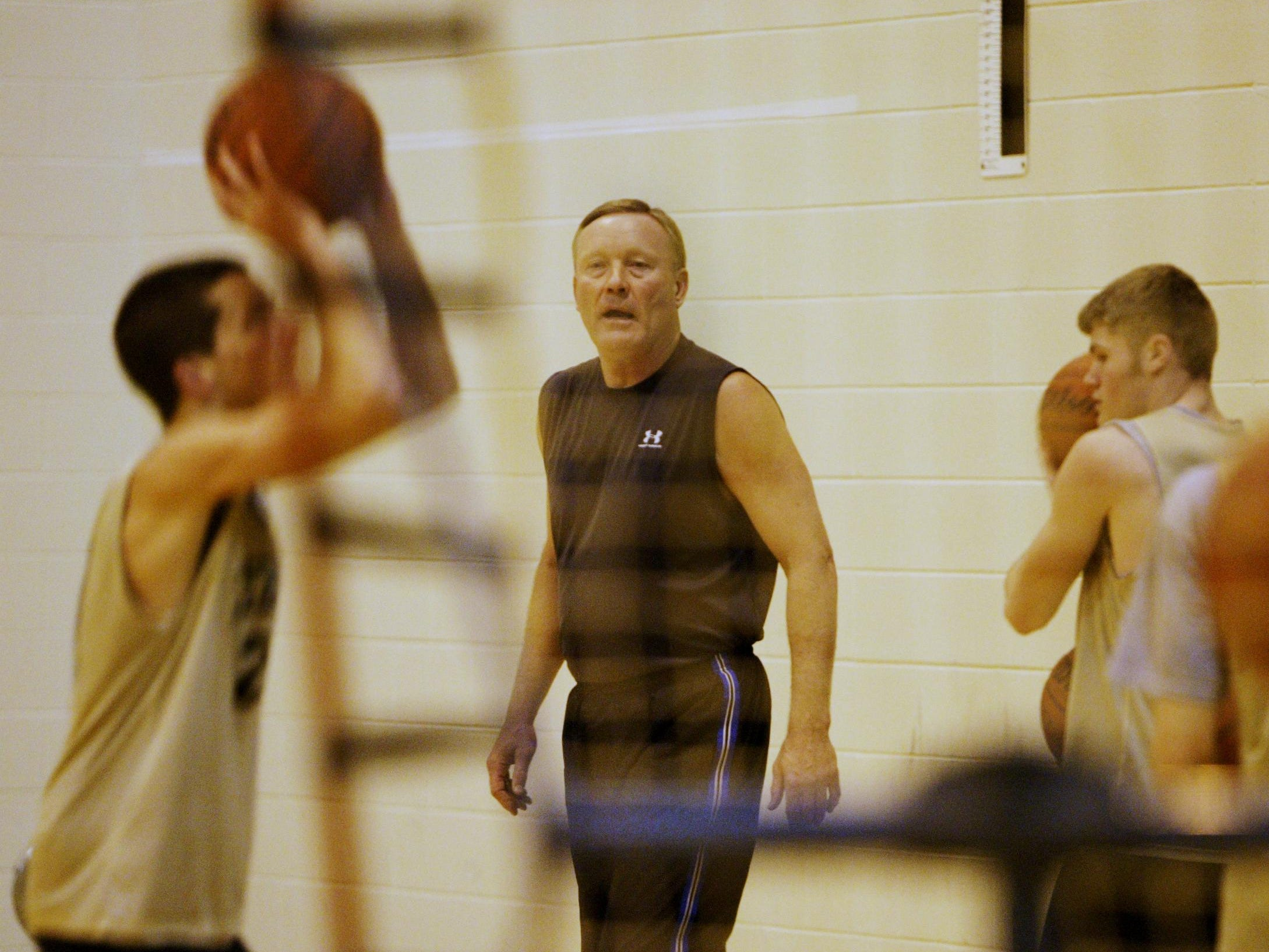 FILE PHOTO FROM 2008 Rick Mount directs Lebanon High School boys basketball players through a shooting drill at the high school Thursday February 16. Mount was one of the greatest shooters in college basketball history at Purdue after winning Mr. Basketball at Lebanon High School. He's been helping the Lebanon girls' basketball team with its shooting for several years, a factor in the team's undefeated/No. 1 ranked season and berth in th e ISHAA regionals. (Joe Vitti/Indianapolis Star)