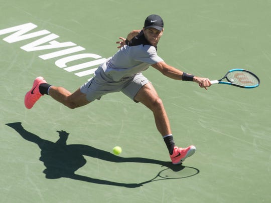 Borna Coric of Croatia plays against South African Kevin Anderson on Stadium One during their quarterfinal match at the 2018 BNP Paribas Open at Indian Wells Tennis Garden on March 15, 2018. Coric won the match 2-6, 6-4, 6-4, 7-6 (3).