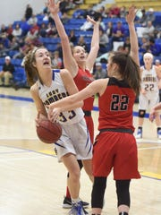 Mountain Home's Anna Grace Foreman is fouled during